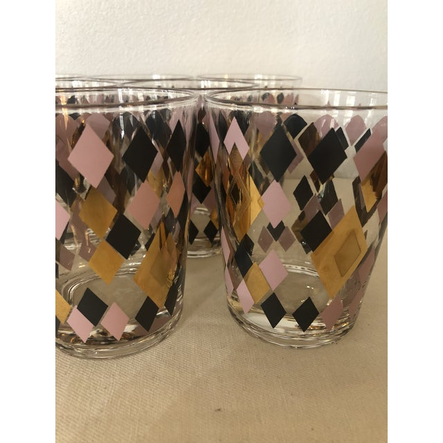 Mid Century bar ware is the best. This set will not disappoint! The harlequin pattern of different sized diamonds is done...