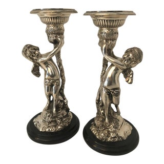 Silver Electroplate Cherub Candlestick - A Pair For Sale