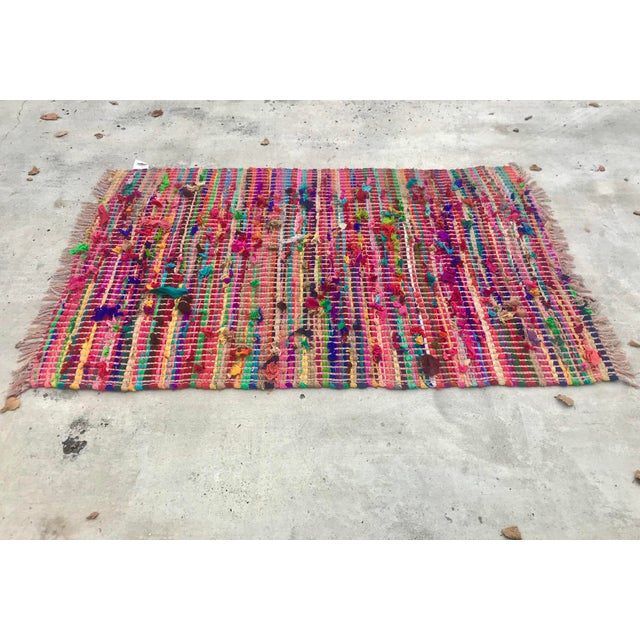 Fun and bright 4 x 6 foot multicolor rug. Made in India of nylon rags this rug is soft and perfect to keep feet warm this...