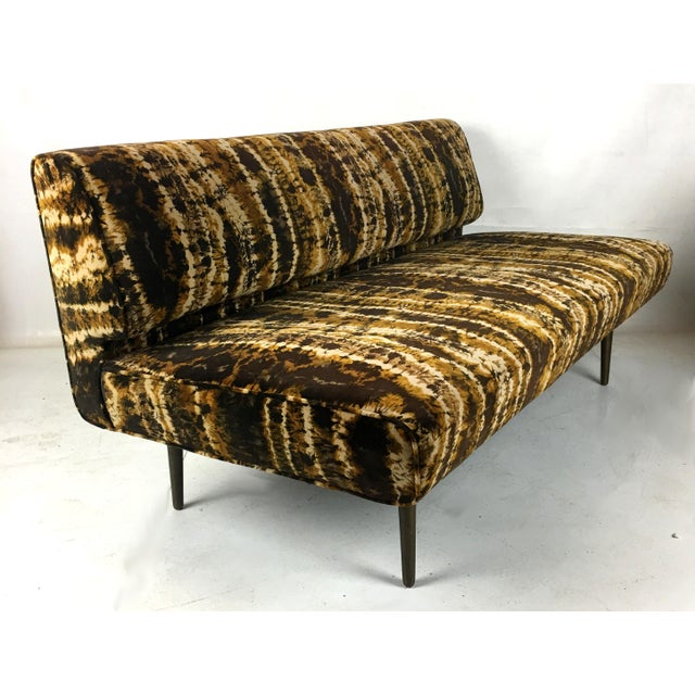 Rare sofa/settee or bench by Edward Wormley for Dunbar. This rare classic sofa features solid brass legs and was...