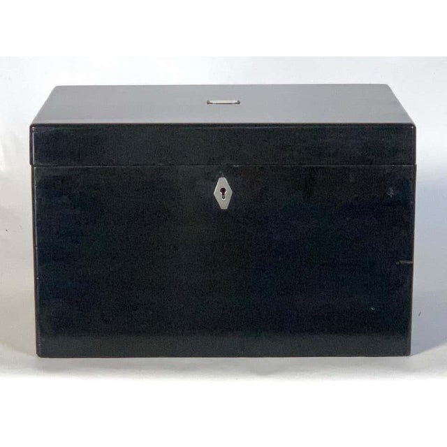 A large Chinese lacquer cigar humidor with engraved silver mount on top opening to reveal a heavily engraved lid and...