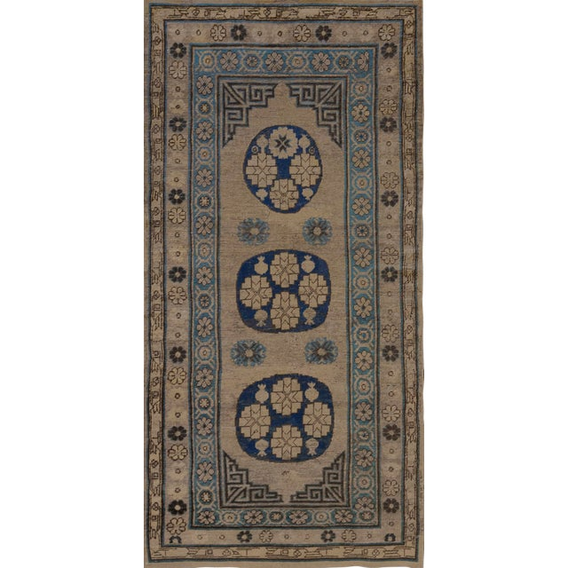 Traditional Antique Handwoven Wool Persian Khotan Runner For Sale