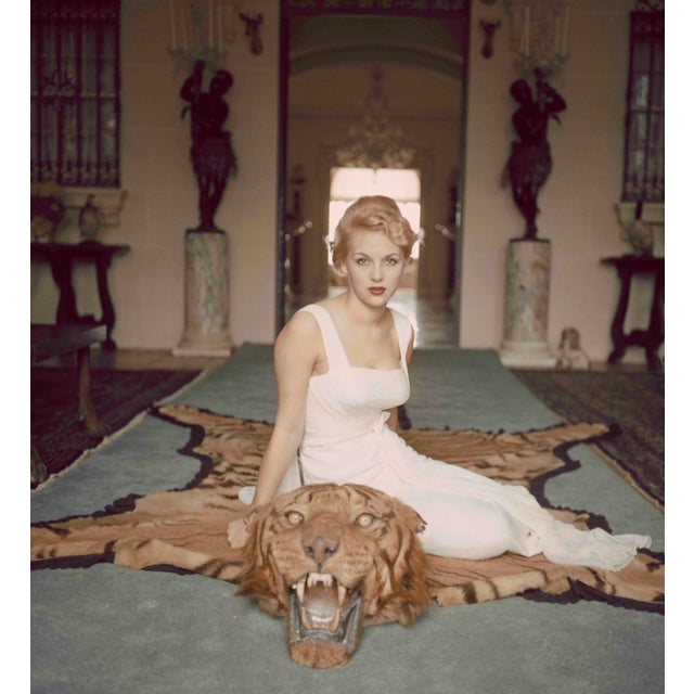 Slim Aarons -Beautiful Lady Daphne Cameron on a Tiger Skin Rug - 1959 Photograph For Sale