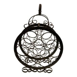 Decorative Vintage Black Wrought Iron Circular 7 Bottle Wine Bottle Rack With Gold Colored Detailing For Sale