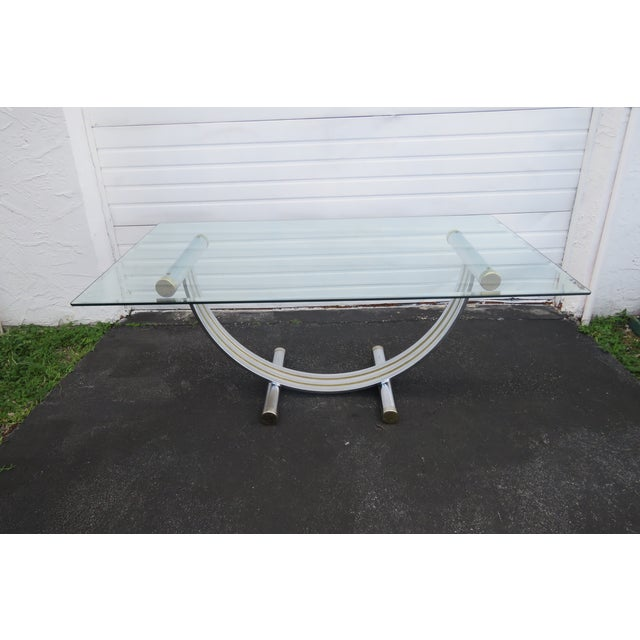 This Set of Dining Table and Eight Chairs is made out of Metal and Glass, and it is in good condition. The table has an...