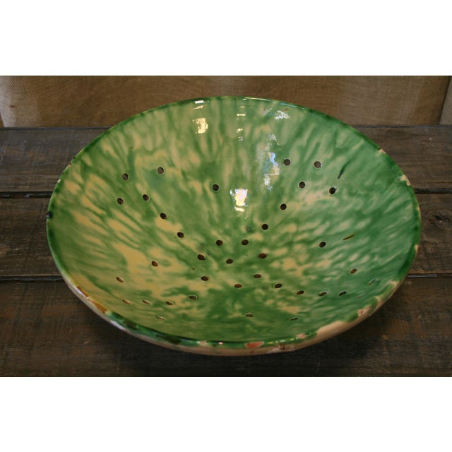 Beautiful antique Spanish bowl, green and white glazing, has small holes possibly was used as a colander.