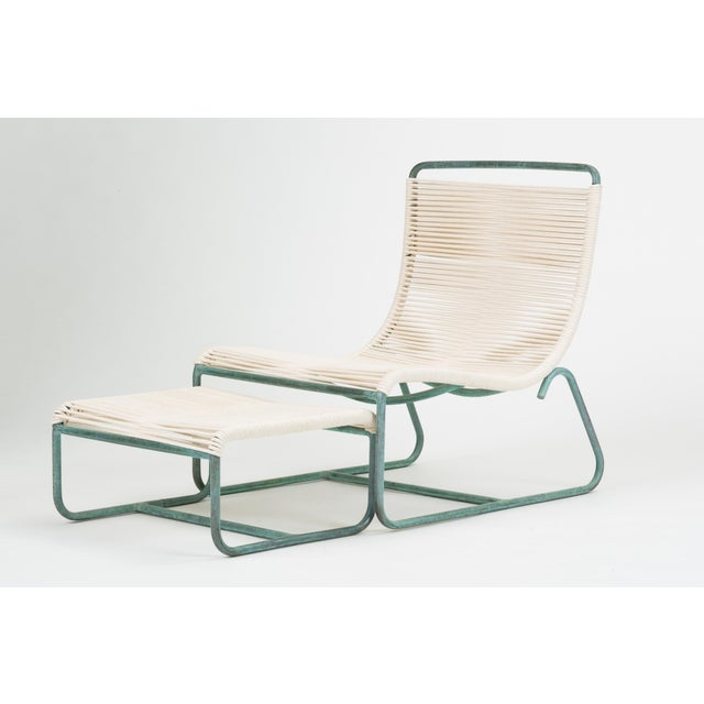 """A low lounge chair, known as the """"Sleigh Chair,"""" by Walter Lamb for Brown Jordan. The chair comes with an ottoman that..."""
