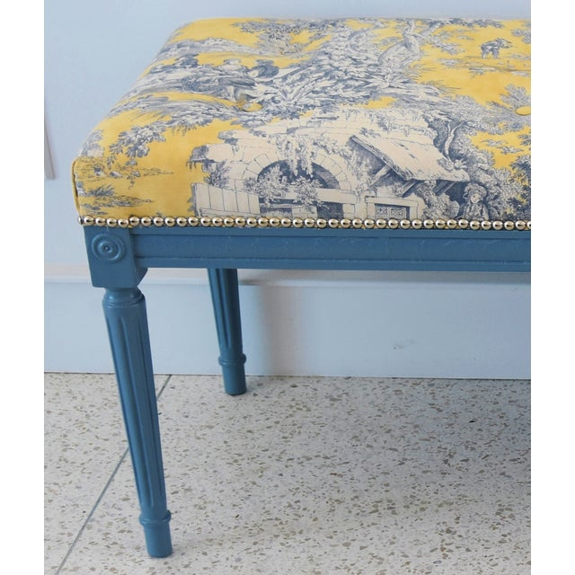 Vintage painted bench newly upholstered in a French farmhouse country inspired 100% cotton toile printed fabric called...