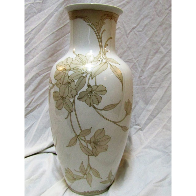 The floral design on this Kaiser Vase is simply stunning. The color is a pearl sand outlined in a very thin gold. The...