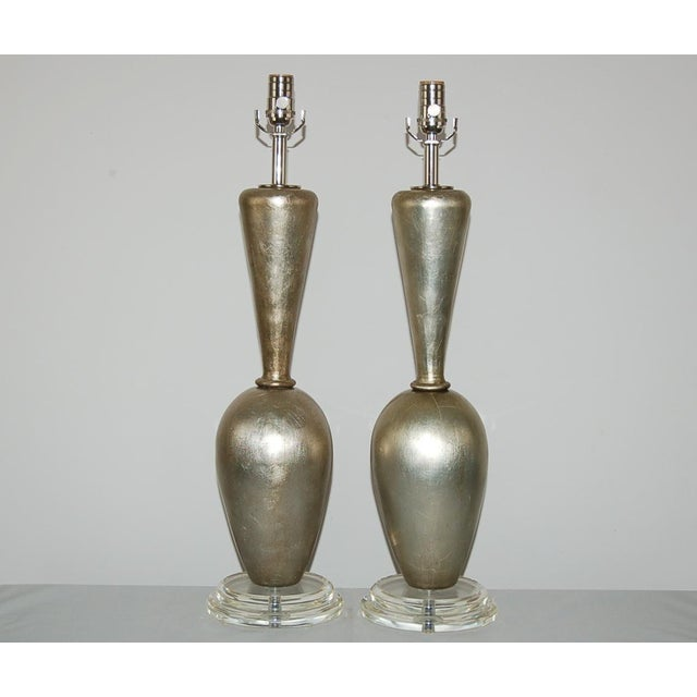 Cast plaster table lamps covered in SILVER LEAF by Swank Lighting. Lovely patina and a great design modeled after a pair...