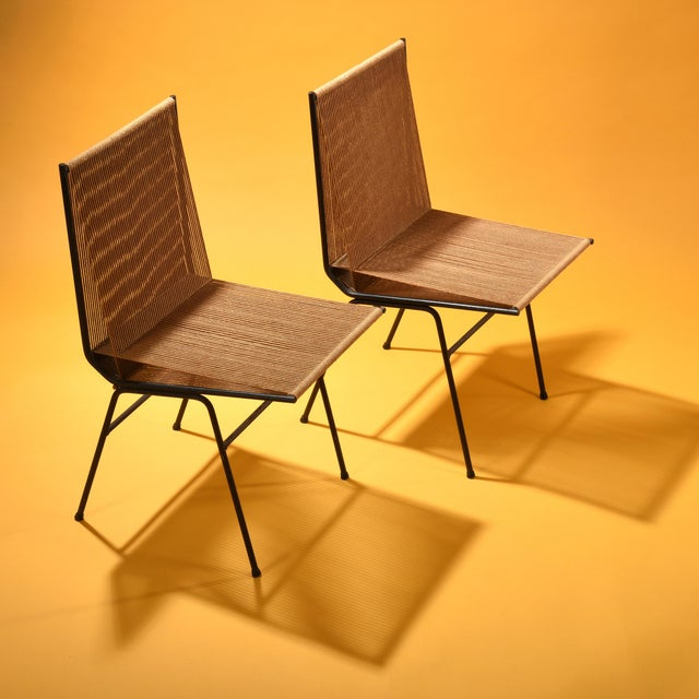 """Pair of """"String"""" lounge chairs manufactured by Allan Gould Designs, New York USA, 1952 Cord, steel frame 31 h x 16 w x 20..."""