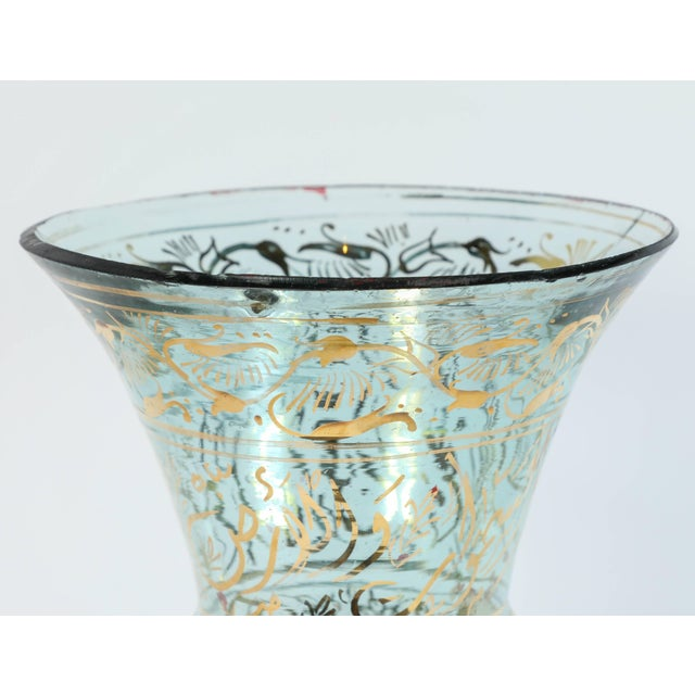Mosque lamp in the Islamic tradition, Mameluk style hand painted blown clear glass with gilded calligraphic inscriptions....