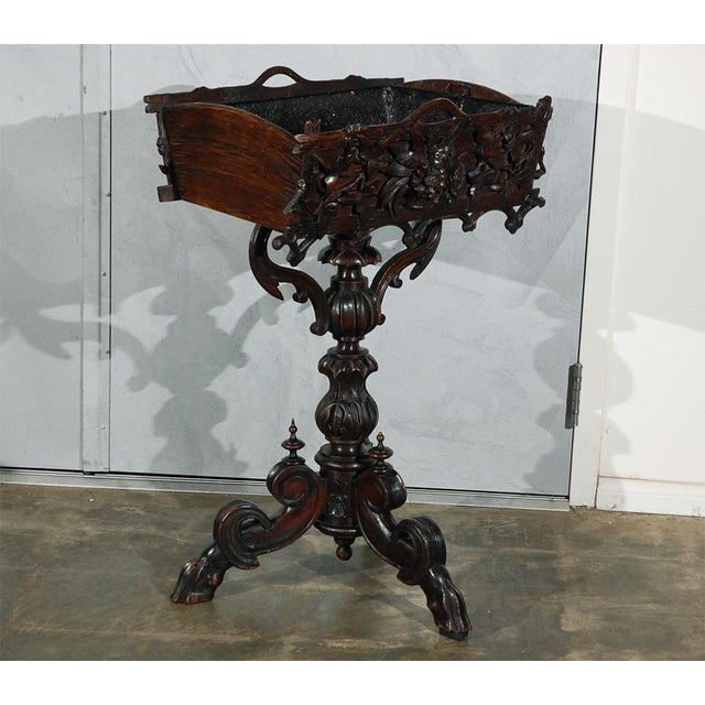 A good Black Forest planter resting on a central column which is supported by three hoofed feet. The planter, column and...