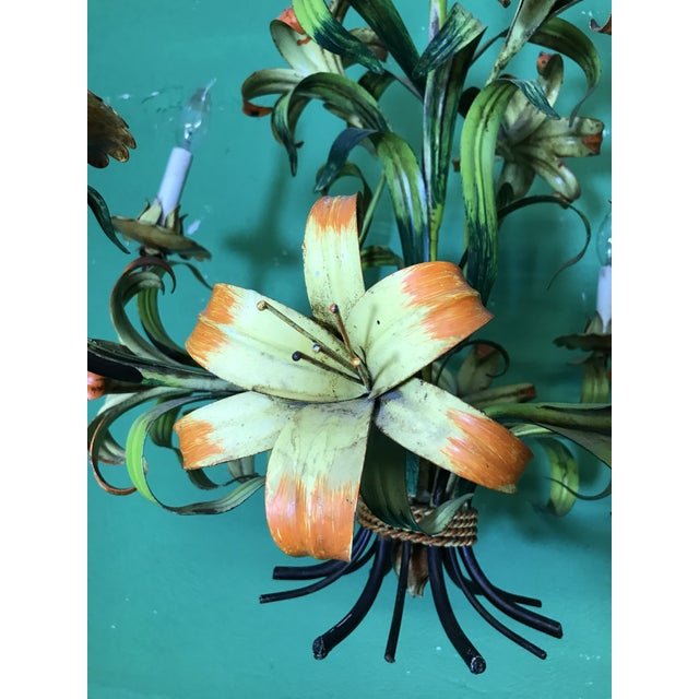 Amazing 1940's Italian hand painted Tiger Lily tole chandelier in as found vintage condition. There are only two of the...