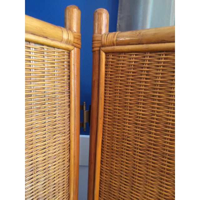 Vintage 3 panel folding screen room divider. Features 3 solid woven rattan panels framed with bamboo molding. The stand is...