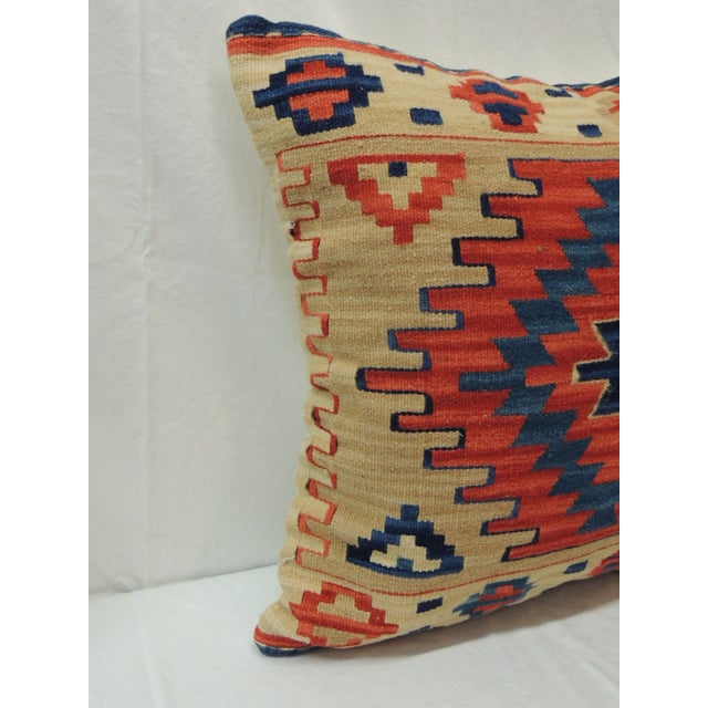 Vintage Orange and Blue Kilim Decorative Pillow. Natural cotton backing and zipper closure. Feather/down insert. From...