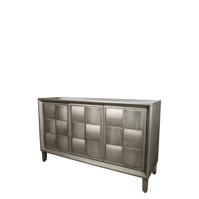 "New 3 door sideboard in silver color. Made in the style of mid-century modern. Interior shelf measurements: 63""w x 18""d x..."