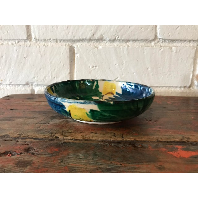 Pretty hand painted small pottery bowl or catch all for coins and keys. Bold colors in green, blue, yellow and brown. In...