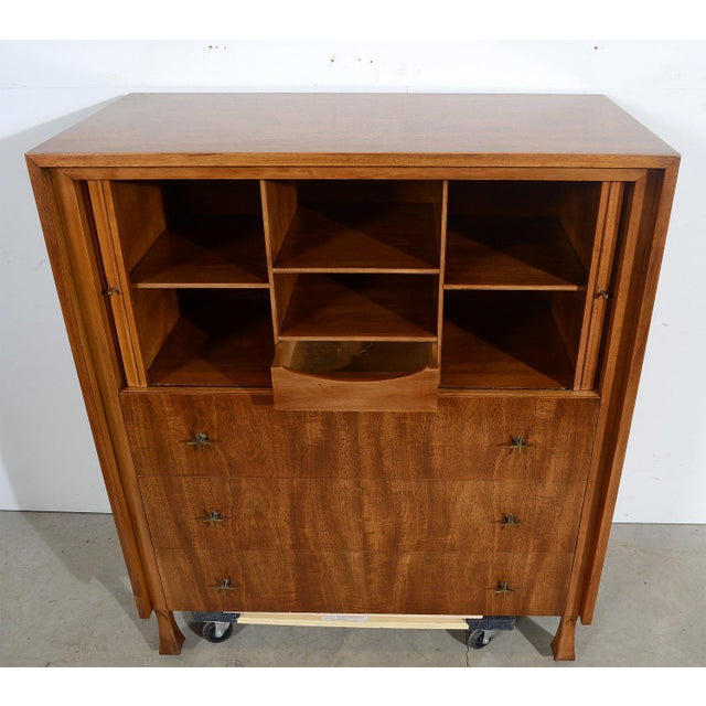 Mahogany John Widdicomb Gentleman's Chest with Tambour Doors Condition- Good vintage condition. Structurally sound....