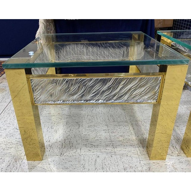 Pair of modern Italian Murano glass and brass end tables, each one with substantial polished brass bases, with four...