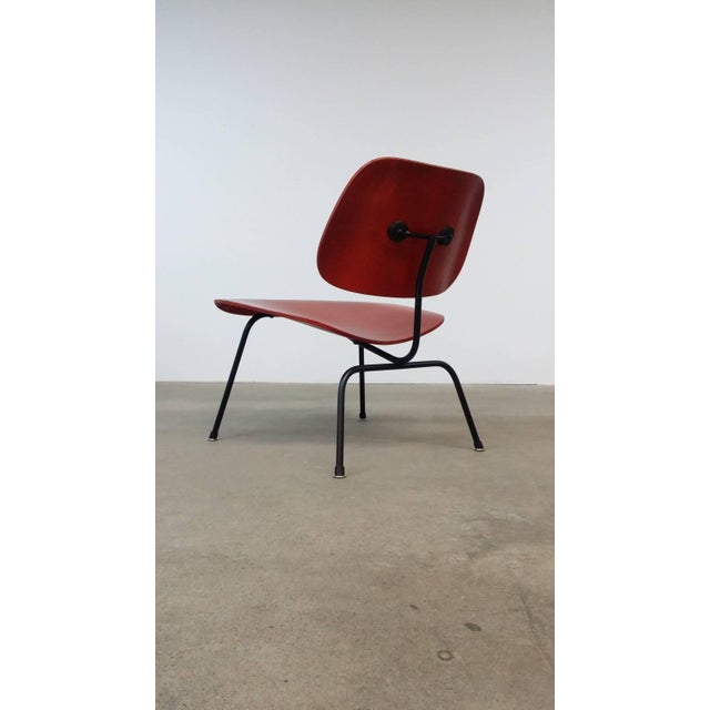 Fully restored first generation, Herman Miller LCM (Lounge Chair Metal) in aniline dye, designed by Charles Eames, circa...