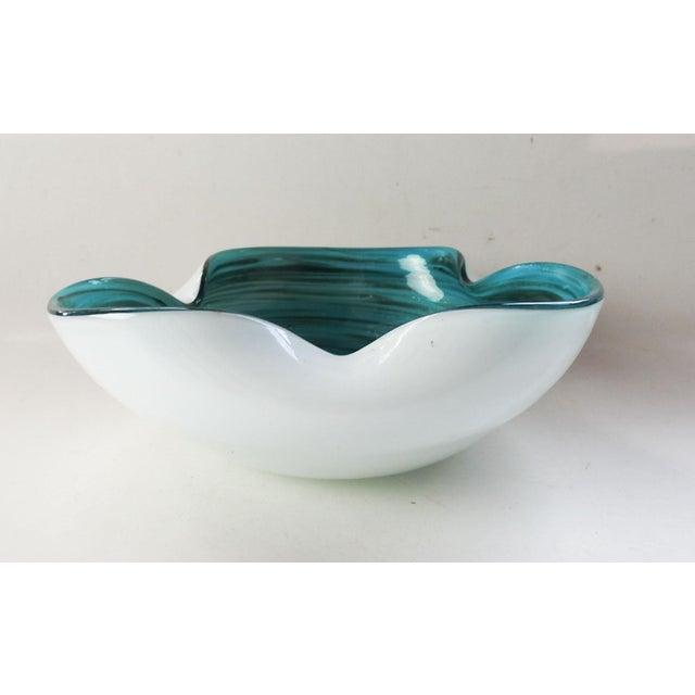 Mid Century Modern Murano glass bowl. Turquoise blue with metallic fleck swirl interior with white exterior.