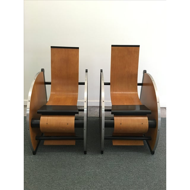 Pair of unique, ebonized wood and metal, Postmodern Art Deco lounge chairs. These may have possibly been theater seats....