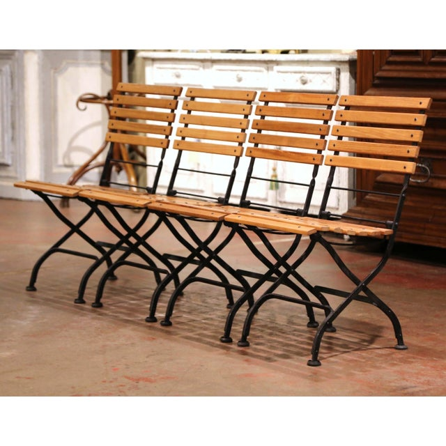 These outdoor garden chairs were crafted by Smith & Hawken in the United States circa 2000-2009. Made of iron and teak...