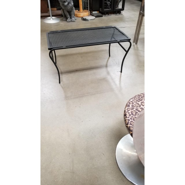 """Vintage Outdoor/Patio coffee table with iron """"U"""" Leg base and steel mesh top by the Woodward company. Table has been..."""