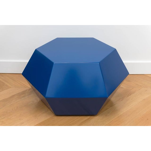 Custom faceted table with a navy lacquer finish.