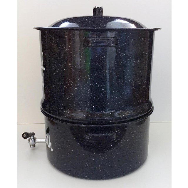 Vintage New England style black speckled enamelware two chamber steamer pot with working spigot. The top section has a...
