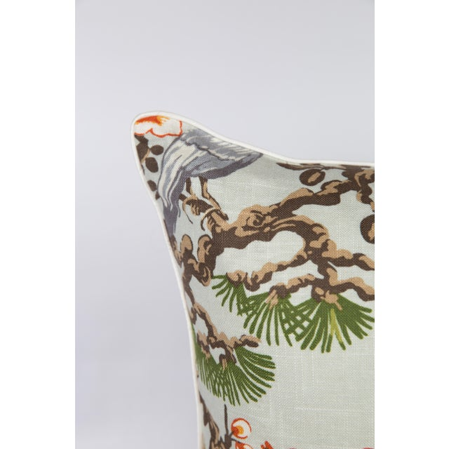 Pair of custom pillows made from chinoiserie bird and cherry blossom pattern fabric. Ivory linen cording and solid...
