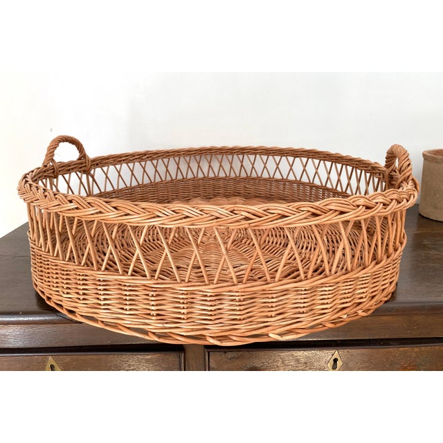 Incredible, dramatic hand woven wicker tray with handles handmade for Sunah Home by group of artisan willow weavers using...