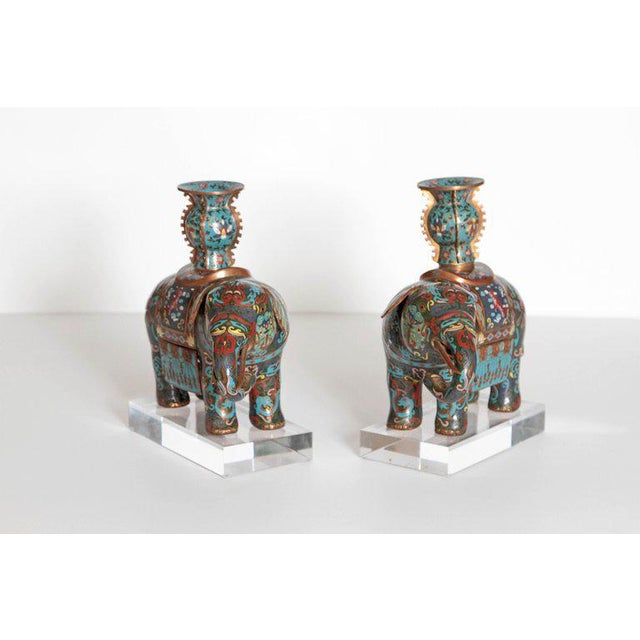 These delightful elephants are truly enchanting. They are multi-color with blue and green being the most prominent colors....