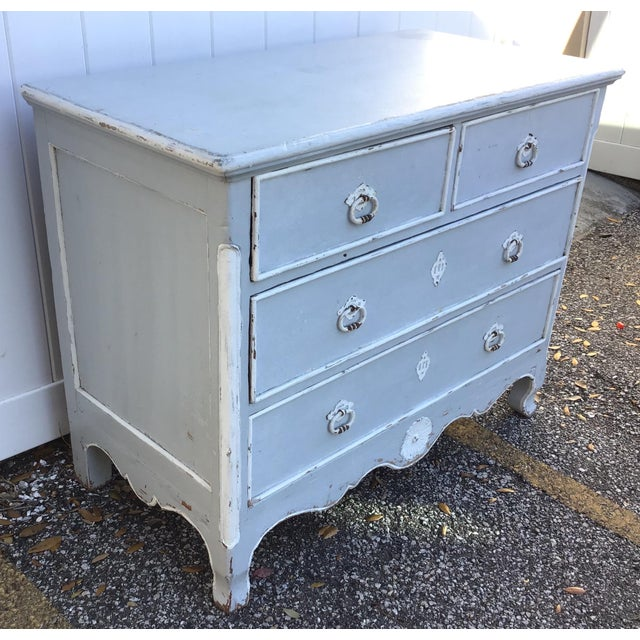 With its antique gray/blue distressed finish and minimal ornamentation, this classic French country style chest is a...