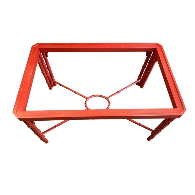 Awesome Baker butler table with removable tray and bamboo style base. The color is a rich red-orange, much like paprika....