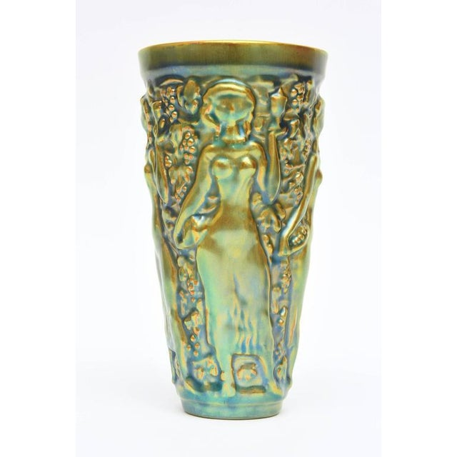 This very early work of the Hungarian;s ceramicist: Zsolnay is a glorious color of elegant nude reliefs in this small...