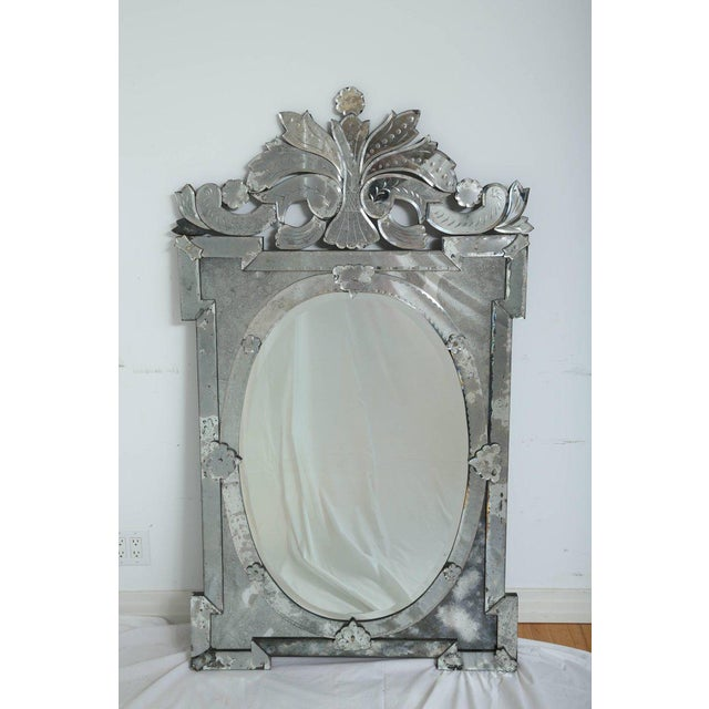 Exquisite large-scale Venetian mirror with beautiful hand etched designs throughout. The mirror features a stunning oval...