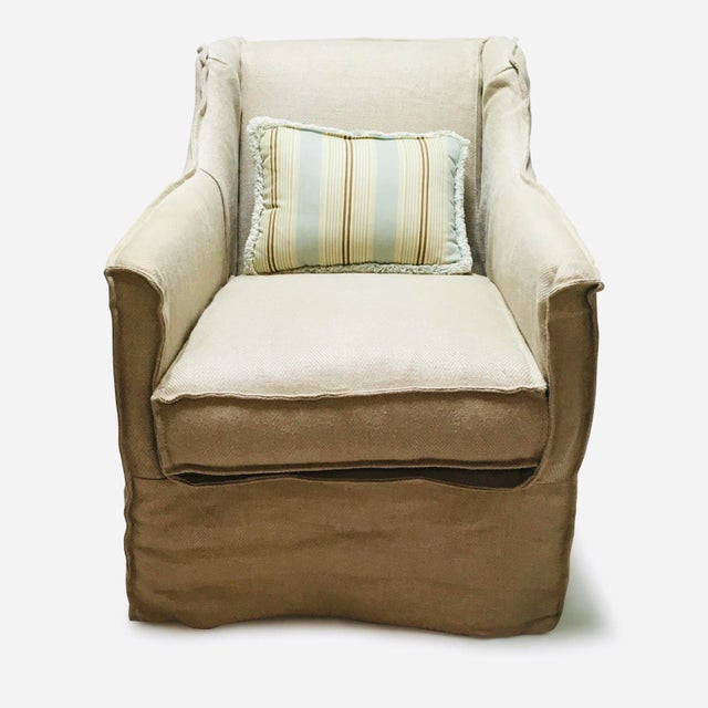 Four Hands Irondale collection Mandy Swivel Chair. Has a slip covered look in natural hemp fabric. Exaggerated welt...