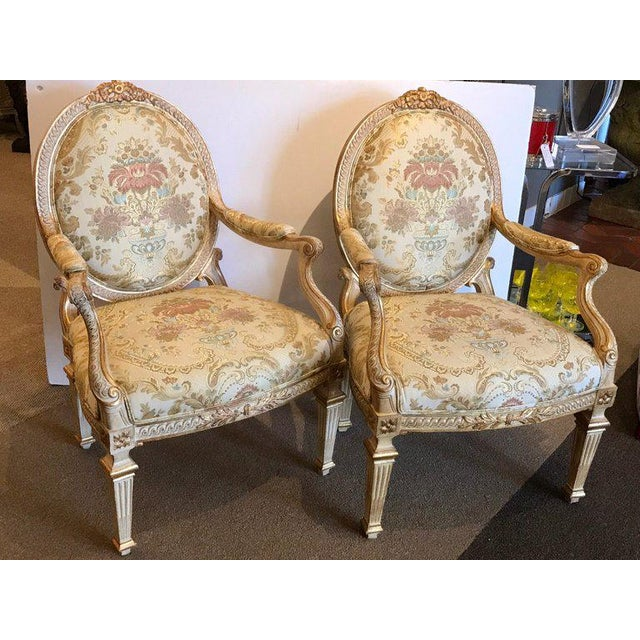 Pair of Louis XVI style carved giltwood bergère chairs with scalamandre fabric, nice generous proportions with parcel gilt...