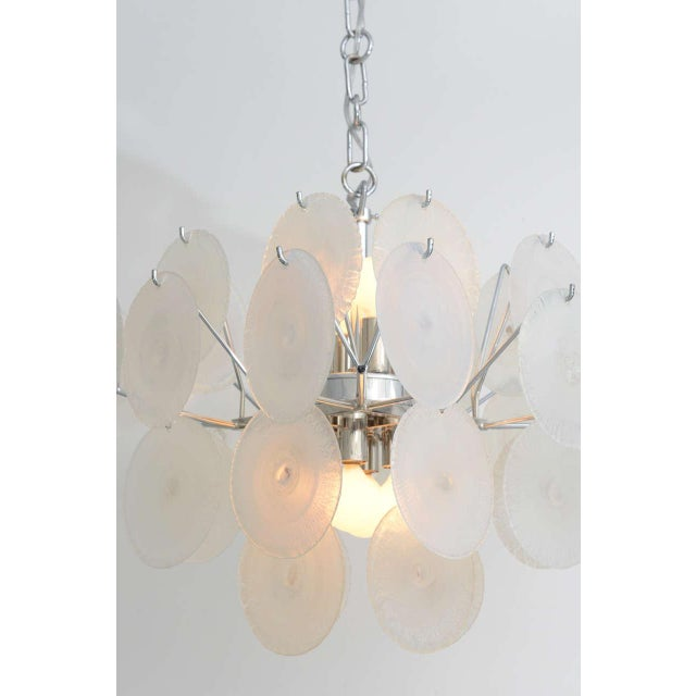 Nicely scaled for bedroom, bath, or entryway - the Murano glass discs on this Vistosi chandelier appear frosty white, but...