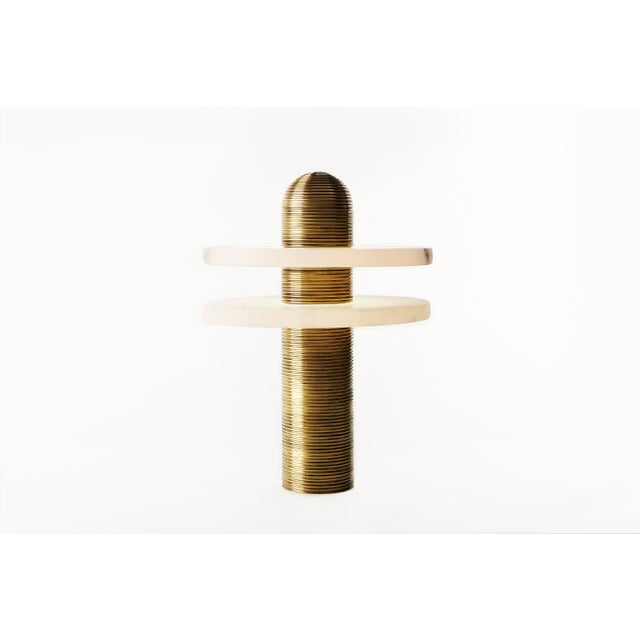 The translucent alabaster planes of the Median series are intersected by a fluted brass Form, referencing traditional...