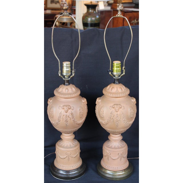 "Mid 20th century ""Borghese"" urn lamps, rams head and swags motif. Urn height is 15.5""."