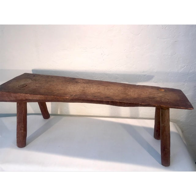 Beautiful antique primitive live edge wood coffee table. Handcrafted with intense peg leg doweling work. The original...