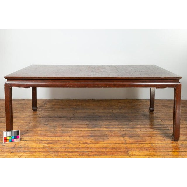 A vintage Thai dining table from the mid-20th century, with open mat top inlay and horsehoof legs. Born in Thailand during...