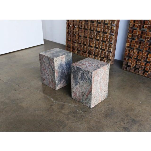 Pair of granite stone occasional tables, circa 1980.