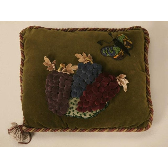 """Great """"character"""" pillow made with all antique fabric and a wonderful imagination. Three bunches of individual made velvet..."""