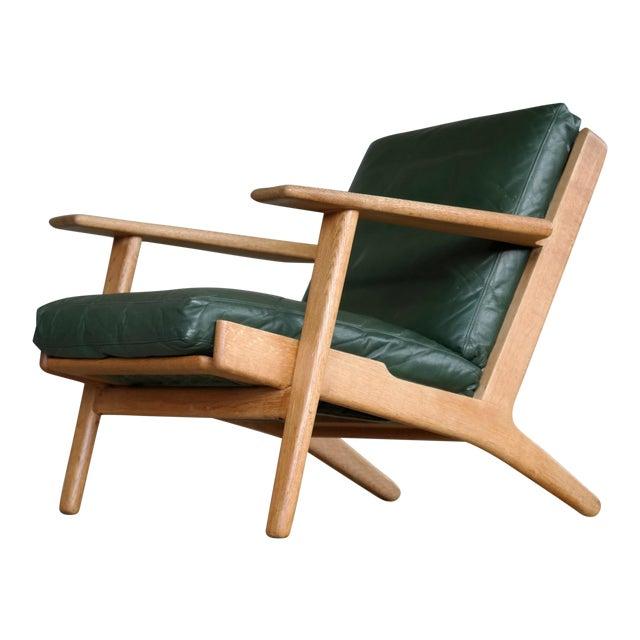 Hans Wegner Highback Lounge Chair Model GE290 for Getama Oak and Green Leather For Sale
