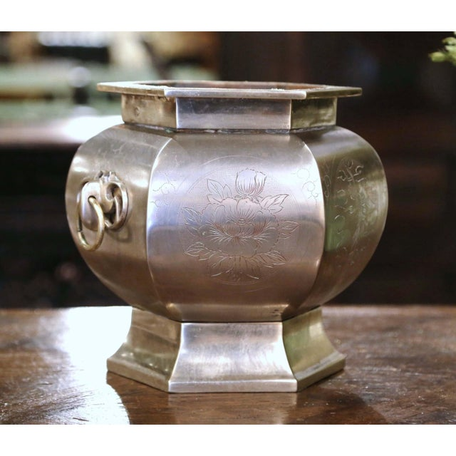 Decorate a dining table with this antique cache pot. Crafted in France circa 1880, and made of bronze with silver, the pot...