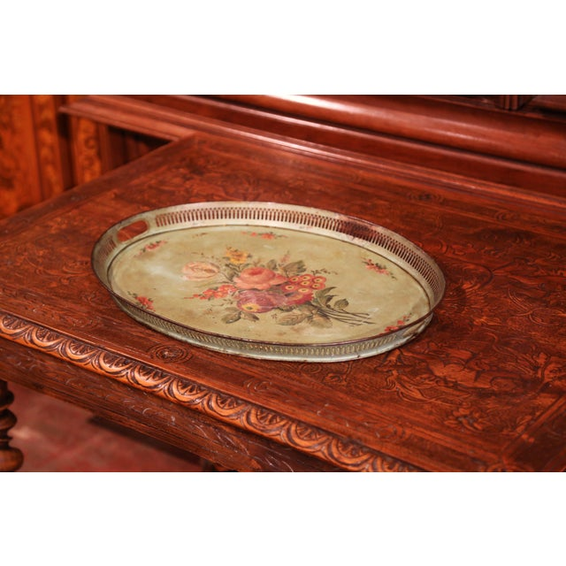 Antique gallery tray from Normandy, France, circa 1870; oval in shape, the colorful tray features two handles around the...